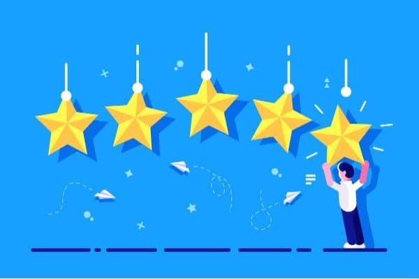 Graphic of 5 stars with a cartoon man hanging the 5th star.