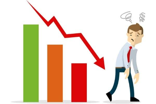 Graphic of a business owner and a chart with a downard trend.
