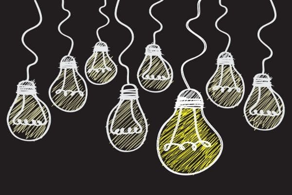 Hand drawn light bulbs representing good ideas for job posting SEO.
